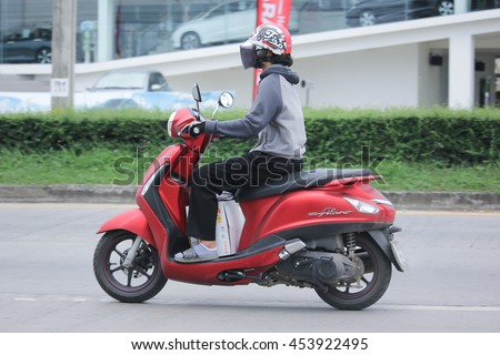 CHIANGMAI, THAILAND -JULY 17 2016: Private Yamaha Filano Motorcycle. Photo at road no.121 about 8 km from downtown Chiangmai, thailand. #453922495