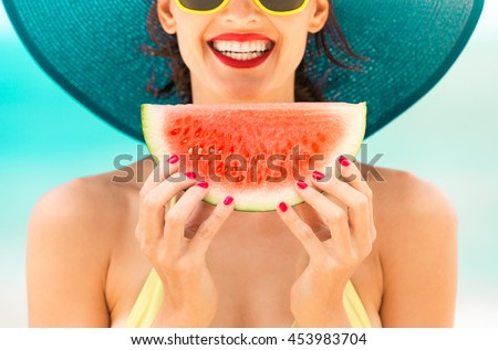 Fun beach summer holiday concept.  Woman holding watermelon on the beach.  #453983704