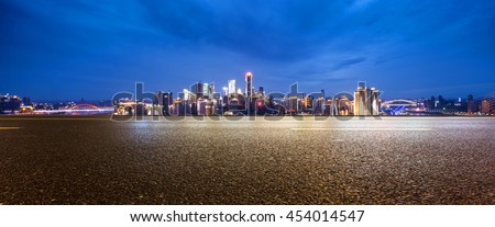 cityscape and skyline of chongqing at twilight on view from empty asphalt road #454014547
