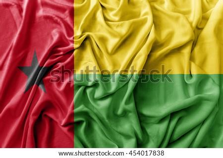 Ruffled waving Guinea Bissau flag #454017838