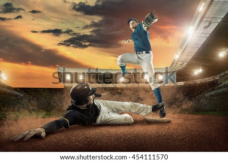 Baseball players in action on the stadium. #454111570