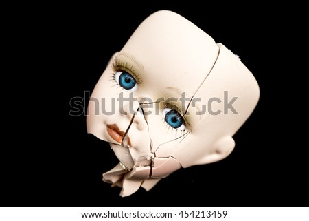Broken Doll Face and Head on Black Background