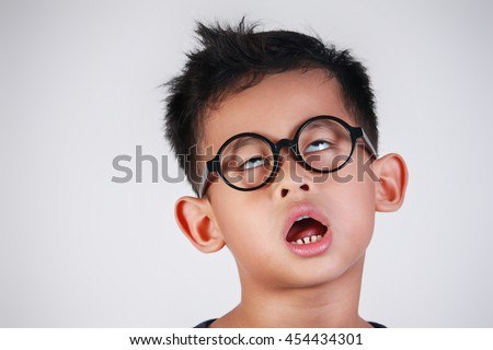 Portrait of Asian boy with glasses showing very lazy unhappy bored and tired gesture