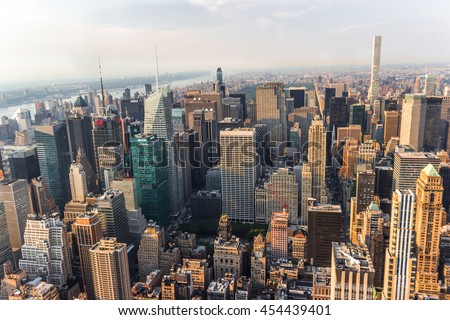 NEW YORK, UNITED STATES - JUN 22, 2016: New York City Manhattan street aerial view with skyscrapers, pedestrian and busy traffic. Sun at sunset. #454439401