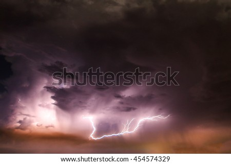 Lightning with dramatic clouds in thailand.Image is dark tone. #454574329
