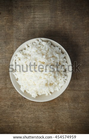 Cooked rice isolated on wooden background #454574959