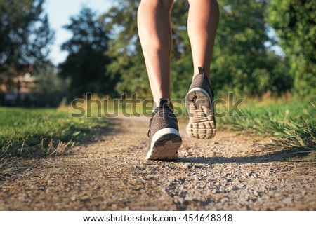 Male Runner feet closeup outdoor during running workout exercise. Sporty healthy sportsman fitness concept. #454648348