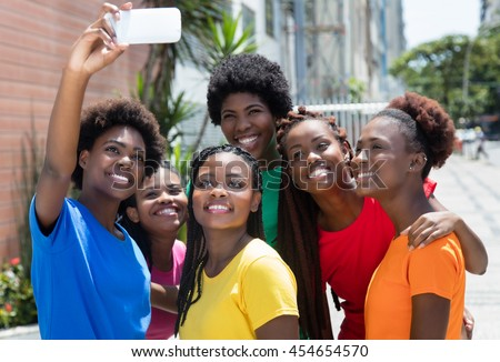 Group of african american woman taking selfie outdoor in the city in the summer