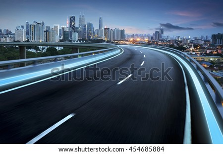 Highway overpass motion blur with city background . #454685884
