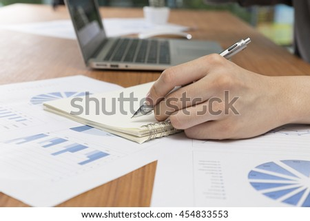 businessman working with document and computer notebook laptop on office desk #454833553