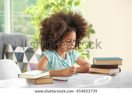 Cute African girl doing homework #454833739