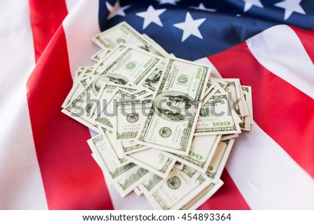 budget, finance and nationalism concept - close up of american flag and dollar cash money #454893364