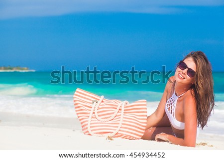 portrait of a young woman having fun at beach #454934452