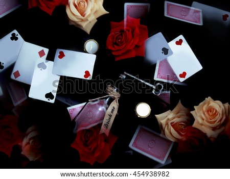 Wonderland playing cards, red and white roses, key, clock, poison. Alice in Wonderland abstract background
