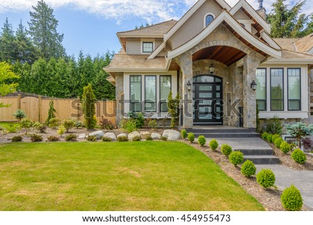 Fragment of a very neat and colorful home with gorgeous outdoor landscape in suburbs of Vancouver, Canada #454955473
