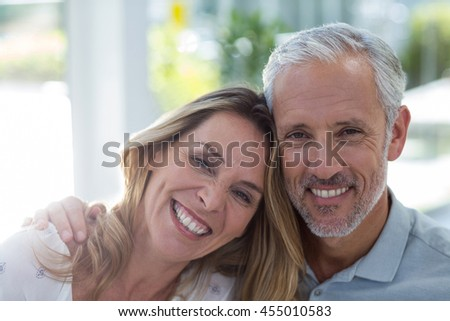 Close-up portrait of smiling mature couple in restaurant #455010583