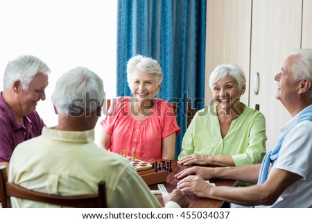 Seniors playing games in a retirement home #455034037