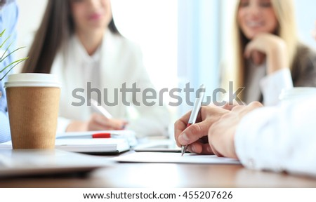 Unrecognizable business person analyzing graphs and taking notes #455207626