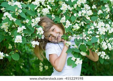Girl and jasmine flowers #455229598