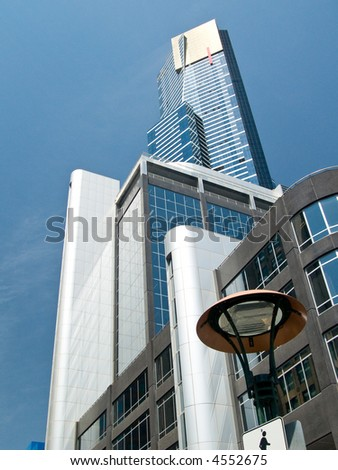 A collection of tall modern buildings looking skywards.  Shot against a blue sky, with fine cloud #4552675