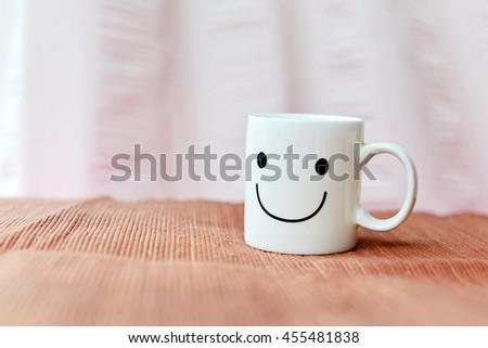 Happy cup on bed. Concept about happiness and waiting for someone. #455481838