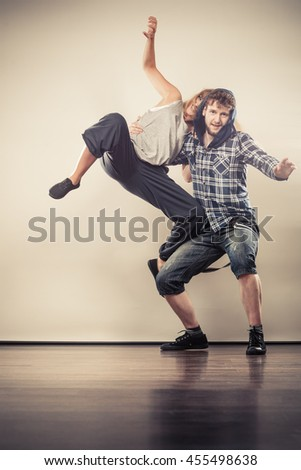 Two modern dancers couple woman and man dancing. Urban lifestyle. Hip-hop generation. #455498638