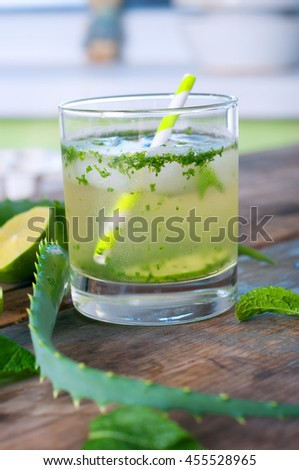 Aloe vera and lime cocktail with mint and ice cubes. Soft summer drinks. #455528965