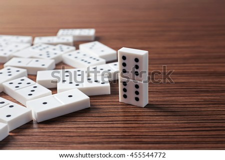 Heap of dominoes on wooden background #455544772