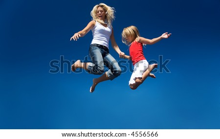 A mother and her daughter jumping high having lots of fun #4556566