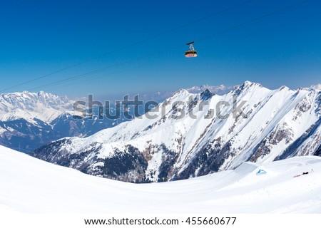 KAPRUN, AUSTRIA - MARCH 20, 2016: Cable car (Gipfelbahn) to Kitzsteinhorn peak during sunny wather in spring season 2016 #455660677