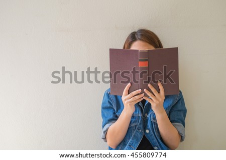 Closeup woman hand holding a book to read #455809774