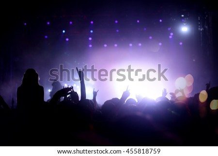 Party people attending a concert and partying #455818759