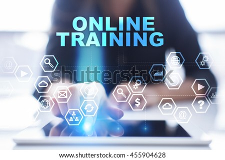 """Woman is using tablet pc, pressing on virtual screen and select """"Online training"""". #455904628"""