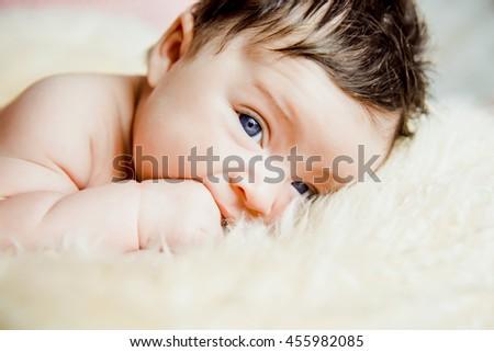newborn baby lying with open eyes in crib #455982085