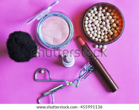 Set of decorative cosmetics on pink  background. Flat composition. magazines, social media. Top view. Flat lay. Makeup products with cosmetic bag. Beauty and Fashion concept.makeup artist cosmetics. #455991136