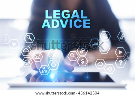 """Woman is using tablet pc, pressing on virtual screen and select """"Legal advice"""". #456142504"""