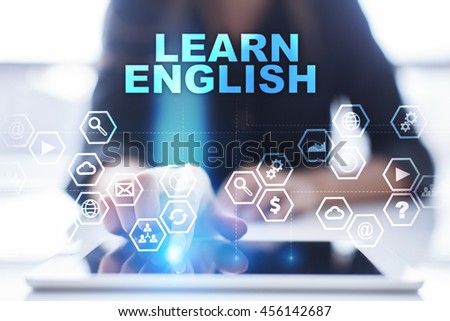 """Woman is using tablet pc, pressing on virtual screen and select """"Learn English"""". #456142687"""