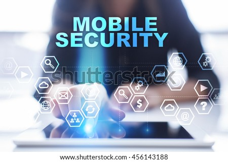 """Woman is using tablet pc, pressing on virtual screen and select """"Mobile security"""". #456143188"""
