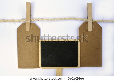 White background with sisal rope and clothes pins with empty copy space tags #456162466