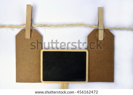 White background with sisal rope and clothes pins with empty copy space tags #456162472