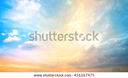 A new heaven and earth concept: Dramatic sun ray with orange sky and clouds dawn texture background #456267475