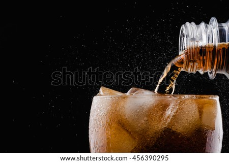 Soft drink : pour soda to a glass / focus at bottle Royalty-Free Stock Photo #456390295