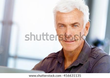 Handsome businessman in office #456631135