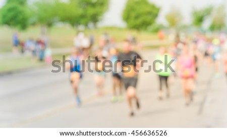 Blurred abstract motion group runners of all abilities of 10K race in Katy, Texas, US. Fitness and healthy lifestyle concept. Athletes on the race. Urban sport event. Panorama style. #456636526