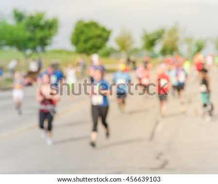 Blurred abstract motion group runners of all abilities of 10K race in Katy, Texas, US. Fitness and healthy lifestyle concept. Athletes on the race. Urban sport event. #456639103