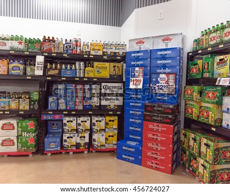 SAN ANTONIO, US - JUN 25, 2016: Various bottles of craft, microbrews, IPAs, domestic and imported beer beers from around the world on shelf display in supermarket. Alcohol background, different beers. #456724027
