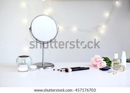 Cosmetic set on light dressing table Royalty-Free Stock Photo #457176703