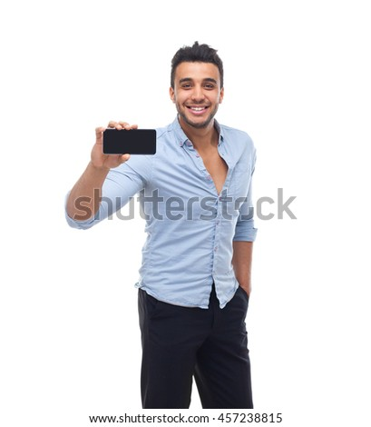 Handsome business man displaying mobile cell smart phone application screen happy smile, businessman wear blue shirt isolated over white background #457238815