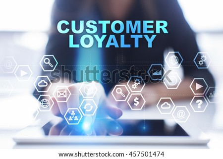 """Woman is using tablet pc, pressing on virtual screen and select """"Customer loyalty"""". #457501474"""