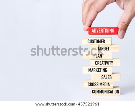 Businessman Building ADVERTISING Concept with Wooden Blocks Royalty-Free Stock Photo #457521961
